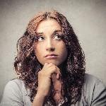 bigstock-thoughtful-woman-looks-up-51205303