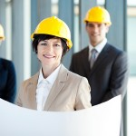 middle aged construction businesswoman holding blue print in fro